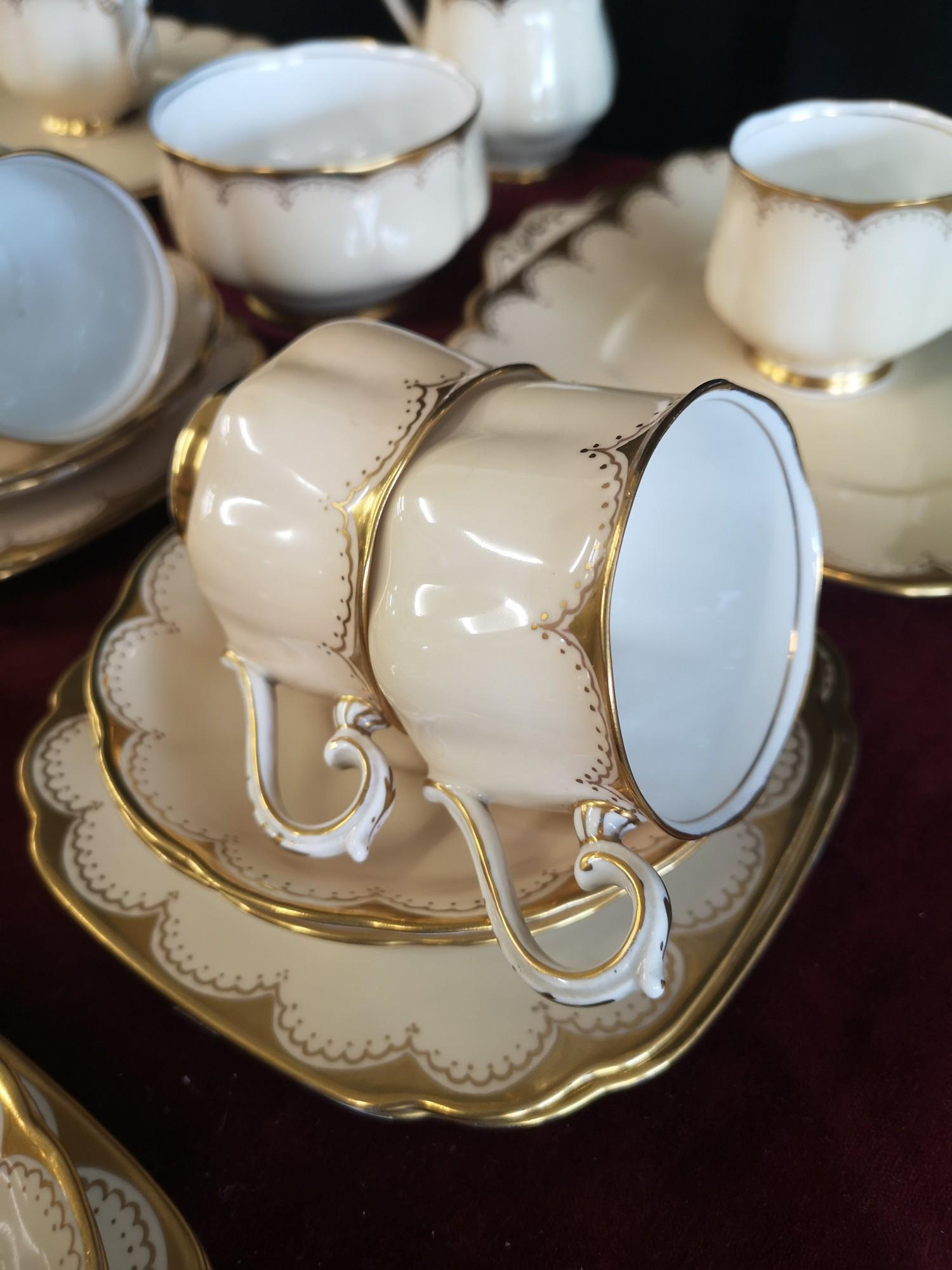 Large 1900s Royal Albert gilt tea set, set in cream back ground. - Image 2 of 10