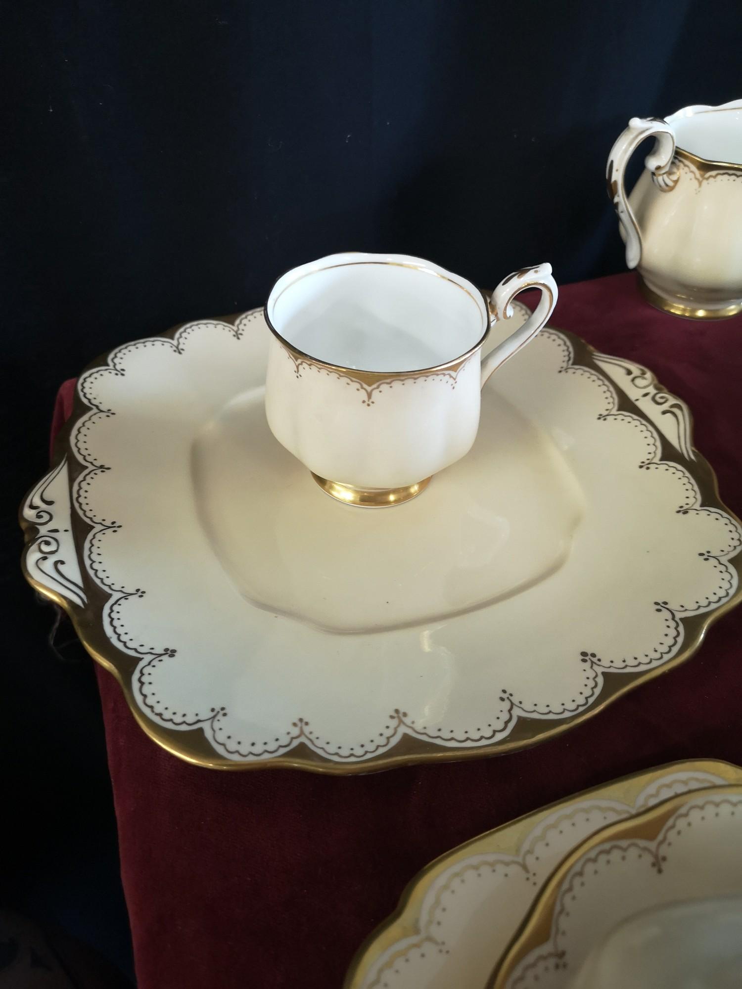 Large 1900s Royal Albert gilt tea set, set in cream back ground. - Image 5 of 10