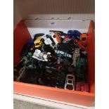 Box of playworn vehicles.