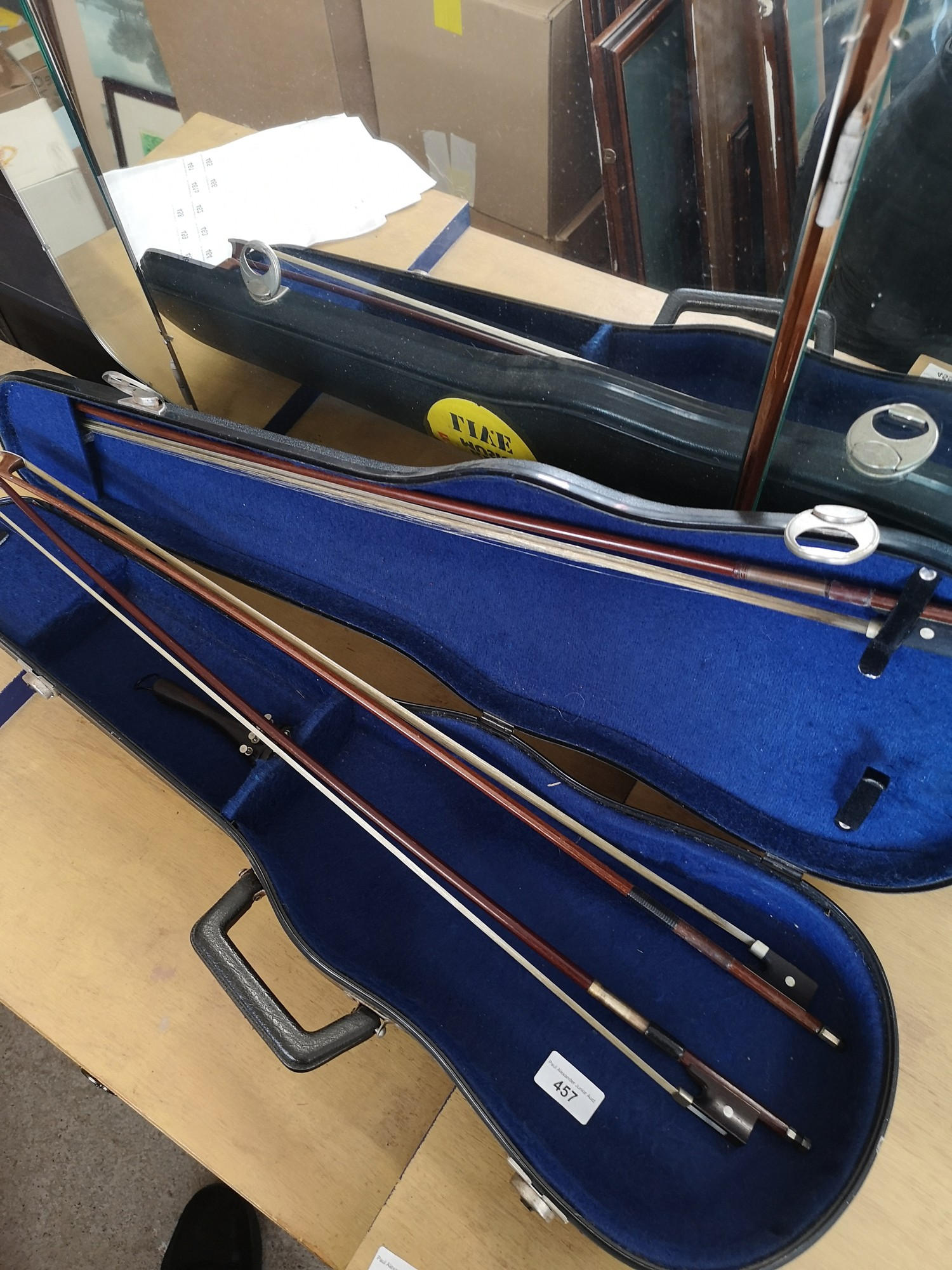 3 violin bows with violin case.