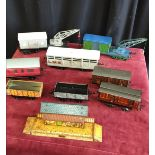 Lot of o gauge tin plate carriages, craines etc.