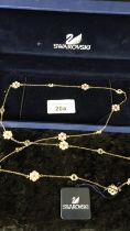 Large Swarovski crystal and enamel necklace with box . 30 inch length chain boxed .