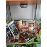 Shelf of xbox 360 games.