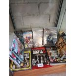 Shelf of PlayStation 3 games.