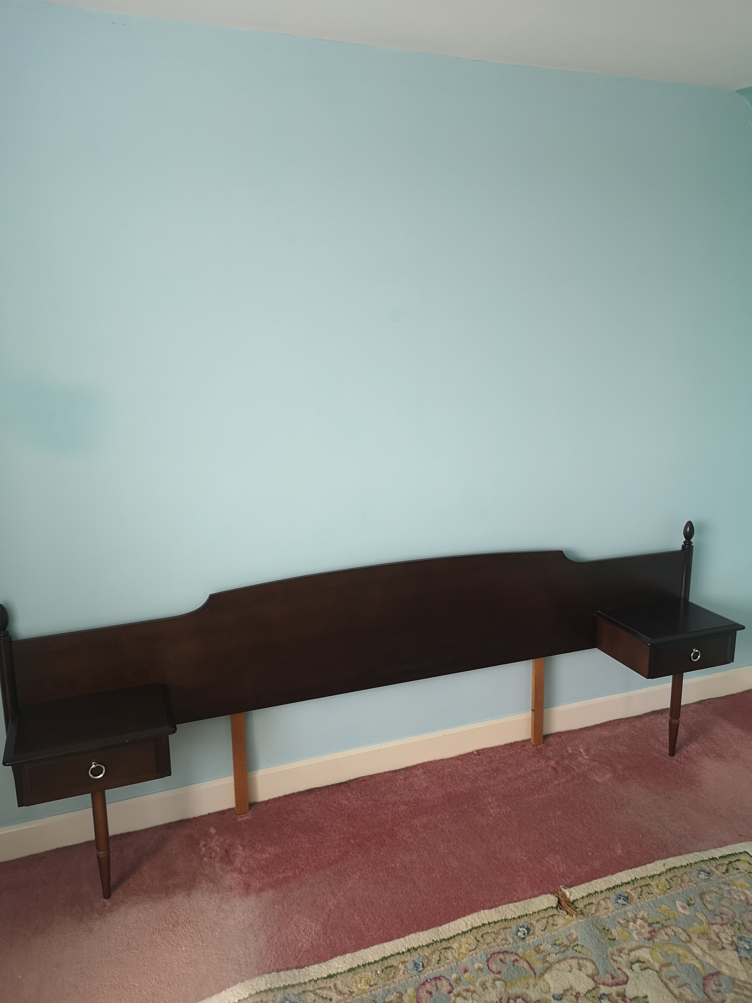 Stag minstrel head board with fitted cabinets.