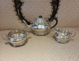 3 piece silver Hall marked tea service on pad feet serrated edges to top and bottom. 900 grams.