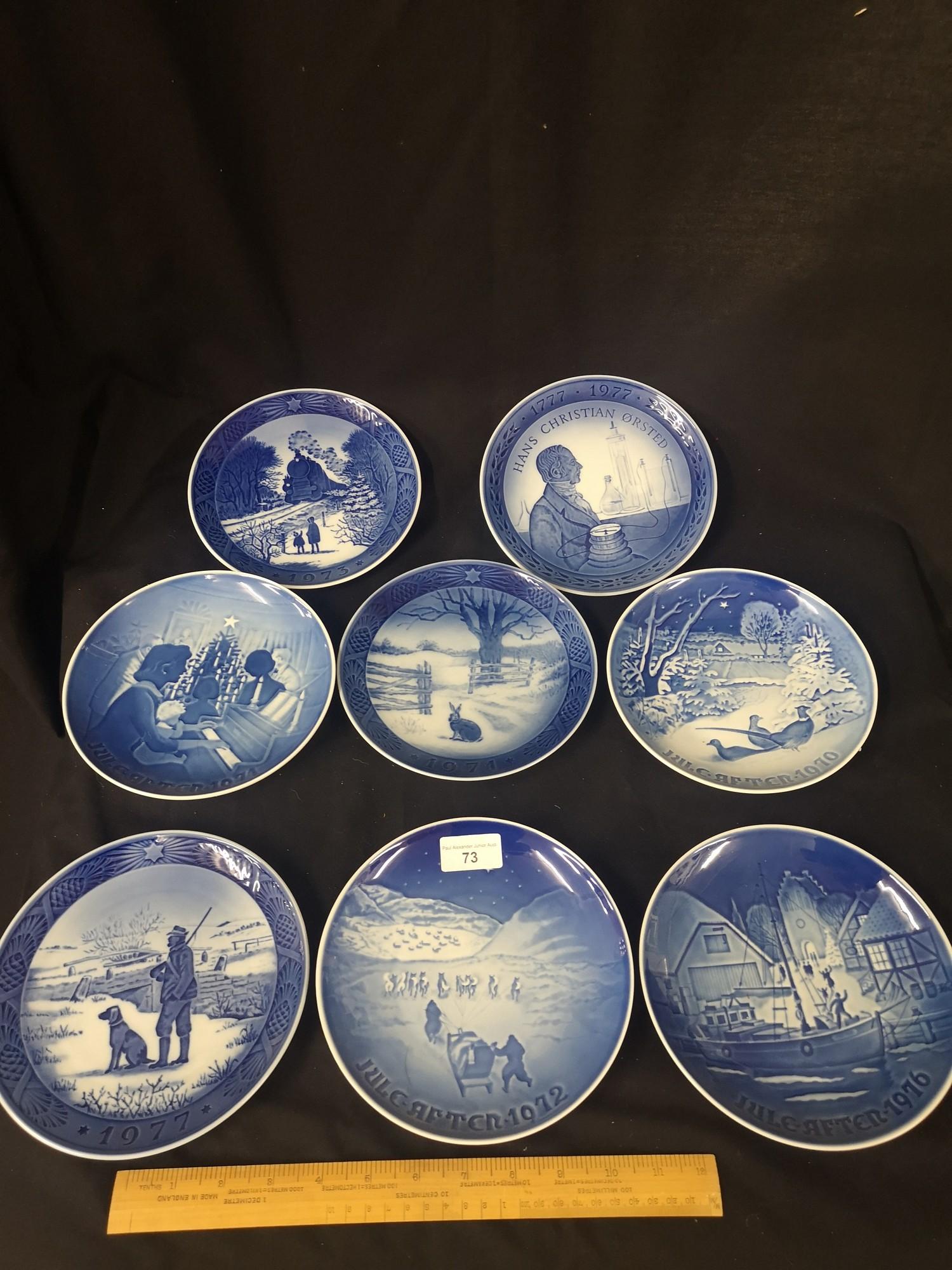 Collection of royal Copenhagen Christmas plates.