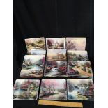 Collection of nature of retreats by Thomas kinkade plates.