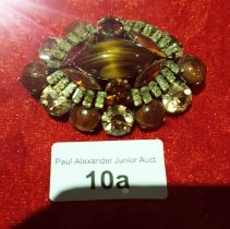 Early large elaborate brooch With Tiger eye Centre with Amethyst and clear Stones Stunning.