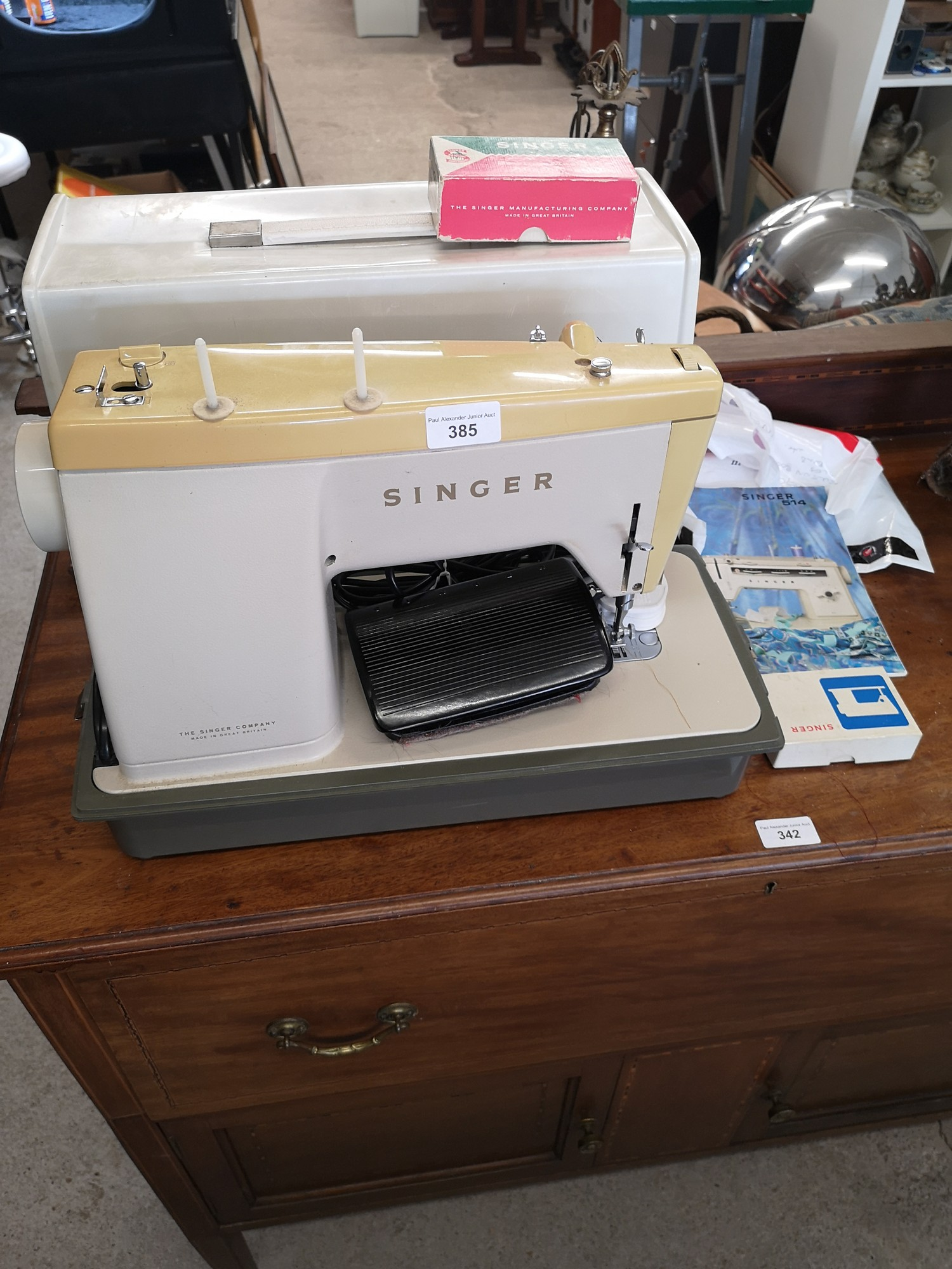 Singer modern sewing machine with accessories.