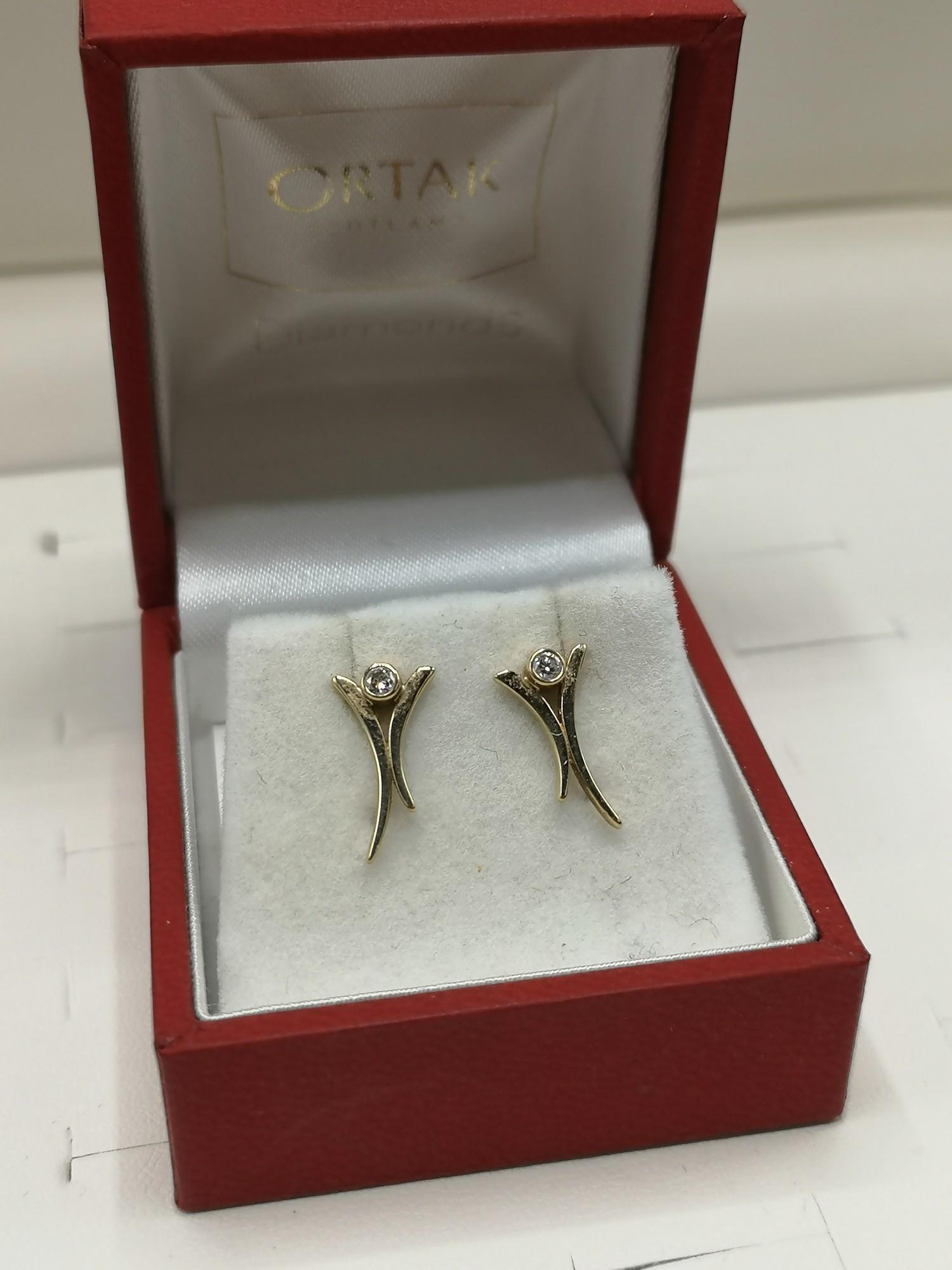 9ct gold ortak earrings set with diamonds.