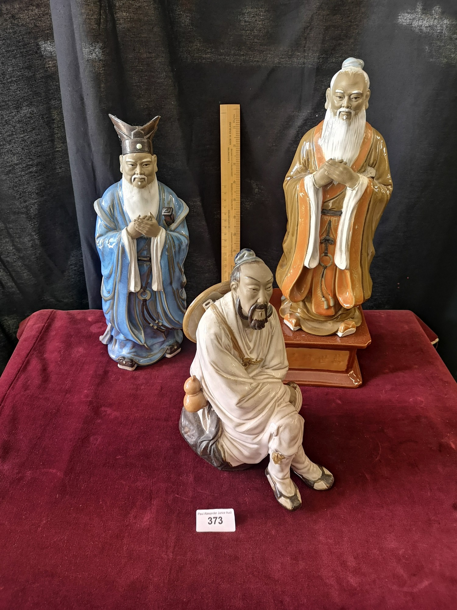 Large Oriental figure on plinth stand together with 2 large oriental figure.