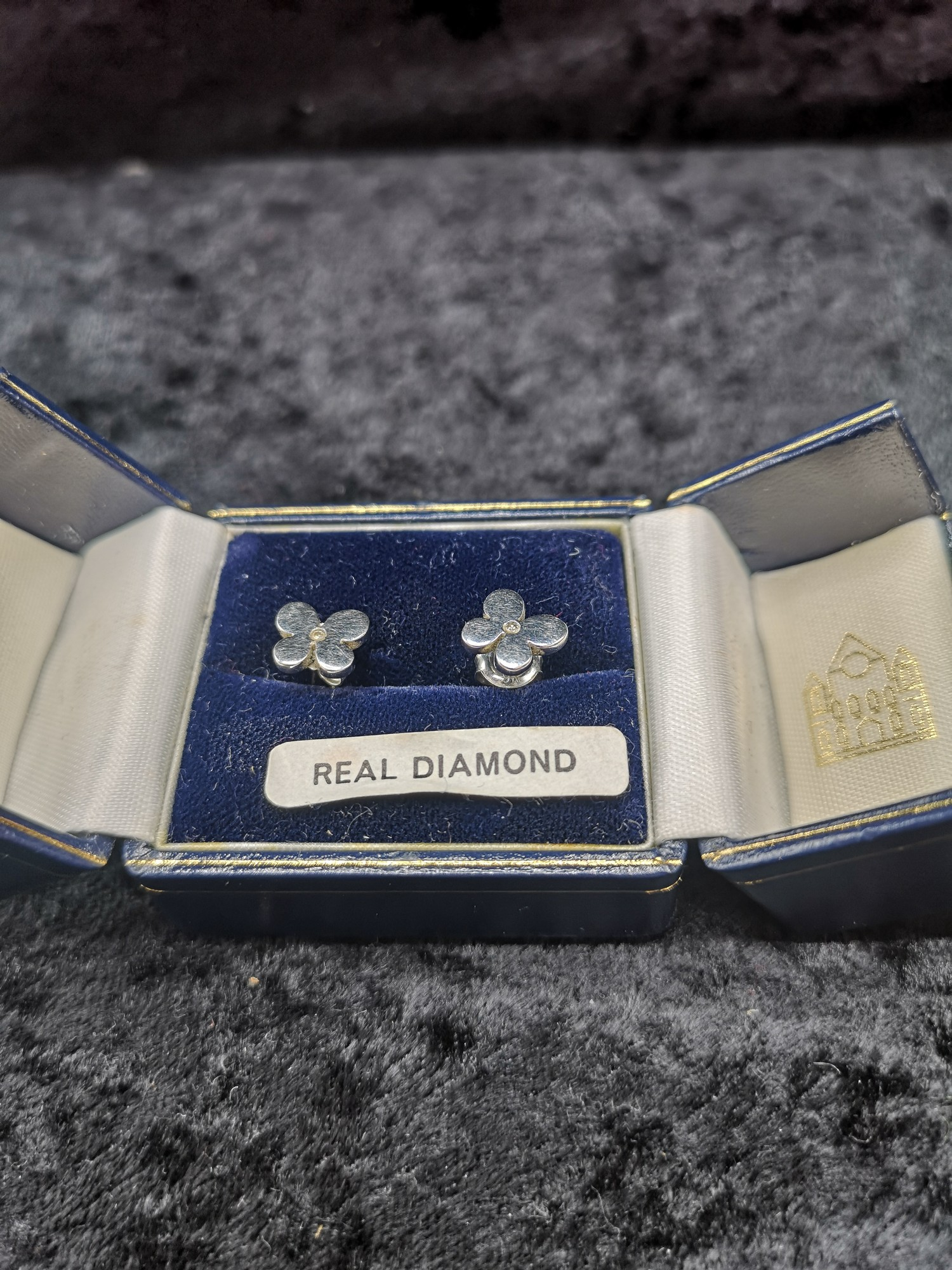 Pair of 9ct gold white 375 Hall Marked diamond earrings.