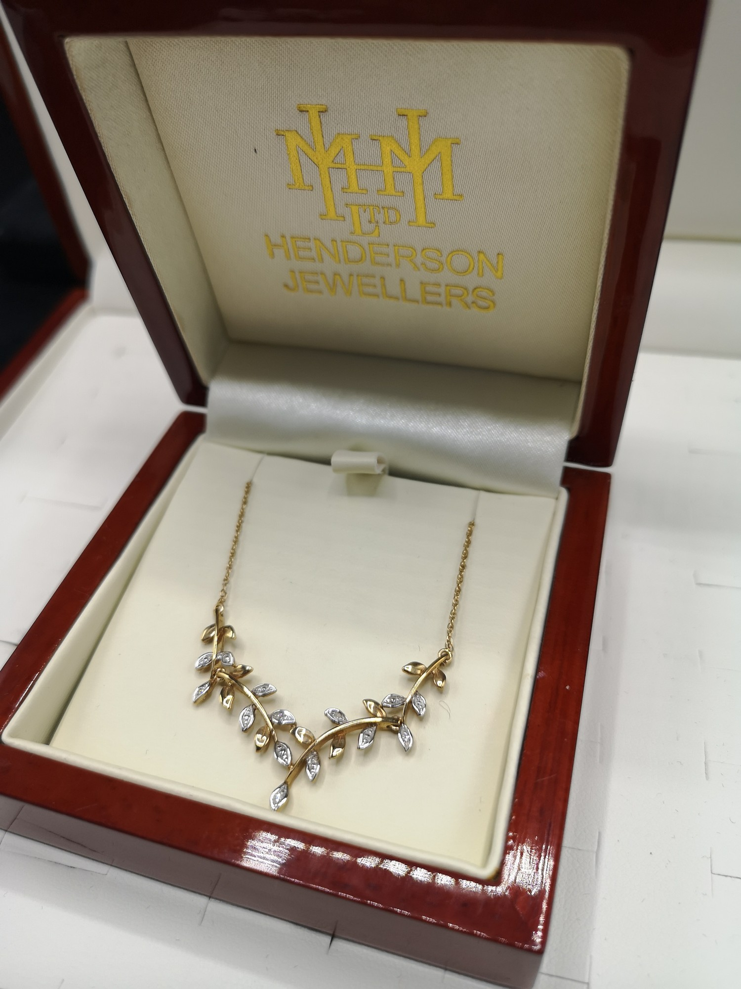 9ct gold necklace set with diamond chip . Tested as diamond s.