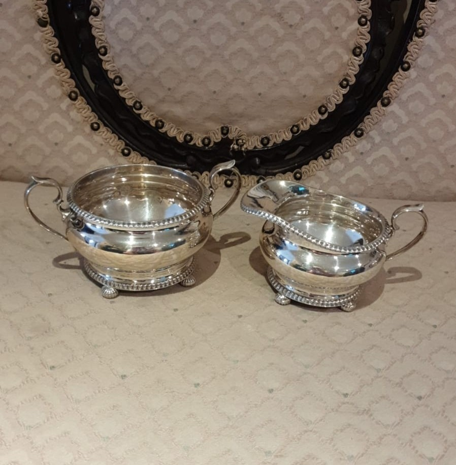 3 piece silver Hall marked tea service on pad feet serrated edges to top and bottom. 900 grams. - Image 2 of 3