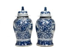 PAIR OF CHINESE BLUE AND WHITE JARS WITH LION LIDS
