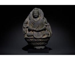 GANDHARA SCHIST STONE FIGURE OF SEATED BUDDHA