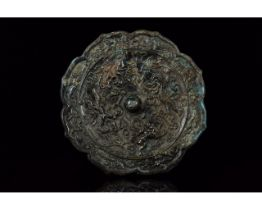 CHINESE TANG DYNASTY BRONZE MIRROR WITH ANIMALS