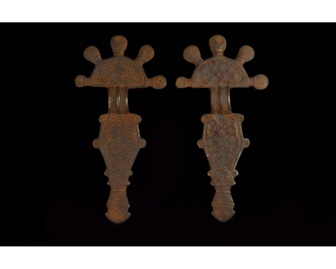 PAIR OF VISIGOTHIC RADIATE HEADED BOW BROOCHES
