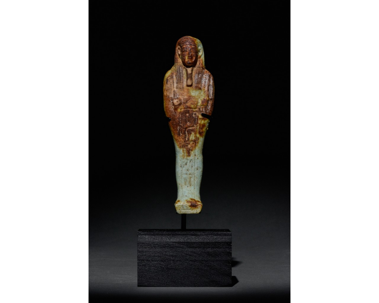 EGYPTIAN FAIENCE SHABTI WITH REDDISH-BROWN AREAS - TRANSLATED