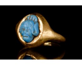 PHOENICIAN FAIENCE GODDESS HEAD IN A GOLD RING
