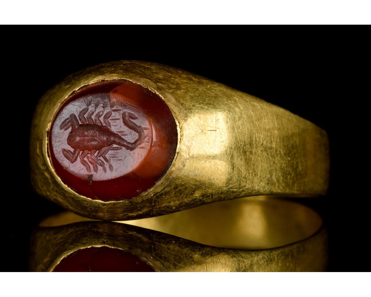 ROMAN GOLD AND CARNELIAN INTAGLIO RING WITH SCORPION