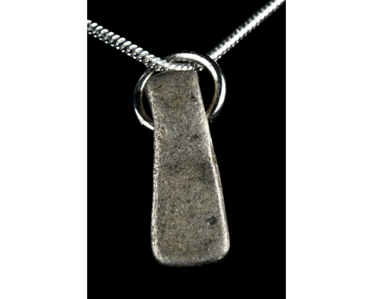 MEDIEVAL SILVER AXE-SHAPED PENDANT