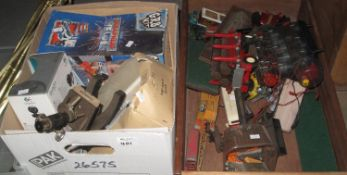 Two boxes of assorted model diecast vehicles, model of a Queen Mary ship, student microscopes