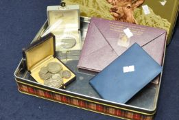 Modern biscuit tin containing assorted coins to include; silver half crown 1920 and a 1999 penny,