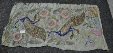 A silk embroidered panel probably Indian with peacock design and silver wire embroidery. (B.P. 21% +