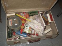 Vintage suitcase containing assorted toys and other oddments to include; vintage cards, wooden