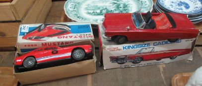 Model Ford Capri car in a Mustang Mach 1 box, together with a king size Cadillac metal made