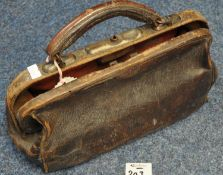 Small leather gladstone type bag with leather handle containing note 'used by a Caerphilly urban