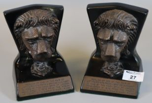 A pair of replica bookends in the form of mask head lions, one of a pair of lifting points from a