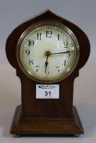 Edwardian mahogany inlaid boudoir type mantel clock, standing on brass bun feet. (B.P. 21% + VAT)