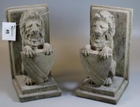 Pair of composite bookends in the form of seated lions with shields. (B.P. 21% + VAT)