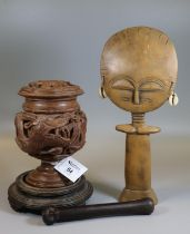 A carved wood pedestal lidded urn on stand, with a deeply carved dragon motif, together with an