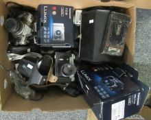 Box of assorted cameras and camera equipment to include; two Lumix digital cameras in original boxes