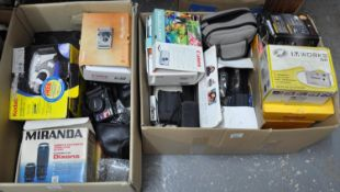 Two boxes of photographic equipment to include: two boxed Miranda lenses in good condition, a