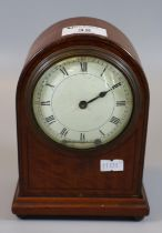 Late 19th/early 20th Century mahogany mantel clock of domed form on bun feet with key. (B.P. 21% +