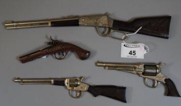Four miniature cap guns, one marked 'Redondo'. (4) (B.P. 21% + VAT)