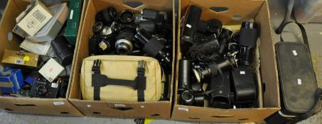 Three boxes of photographic equipment to include a number of lenses: a Soligor autozoom 70-222mm,