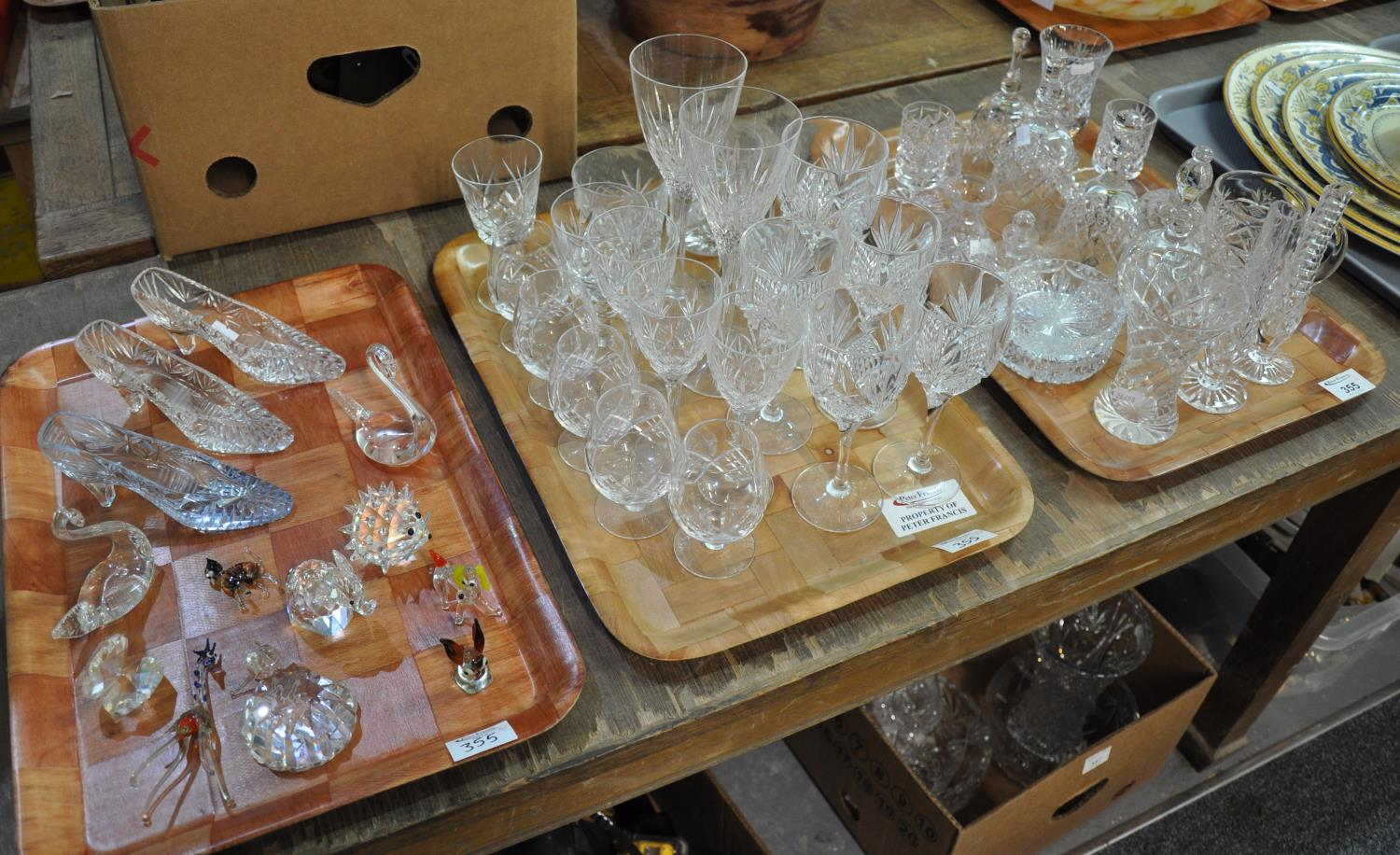 Three trays of various glassware to include: moulded glass shoe ornaments, various animal ornaments;