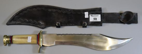 Replica bowie knife with saw back and simulated bone handle in leather scabbard. (B.P. 21% + VAT)