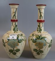 A pair of Victorian opaline glass baluster bud vases having painted floral and foliate designs. (B.
