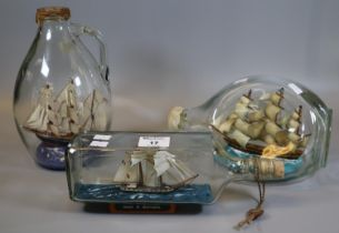 Three glass ships in bottles to include; Prince de Neufchatel U.S.S Constitution etc. (3) (B.P.