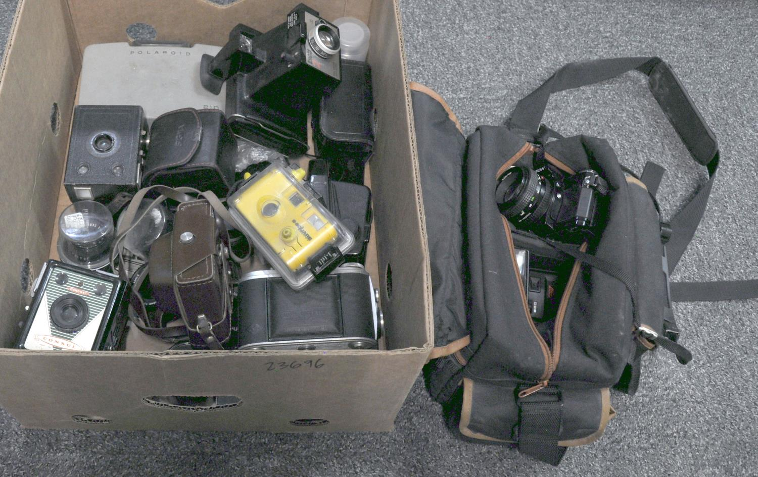 A selection of photographic equipment, various, to include: early Polaroids - the Polaroid Square