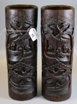 A pair of deeply carved bamboo brush pots depicting figures in a pavilion and Sampan amidst pine