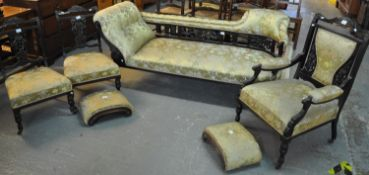 Edwardian ebonised and upholstered parlour suite comprising; chaise longue, pair of side chairs