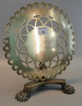 19th Century brass trivet in the form of a pierced circular snap top pedestal table on triform